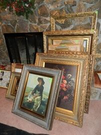 More framed art and empty frames. Many are oil paintings