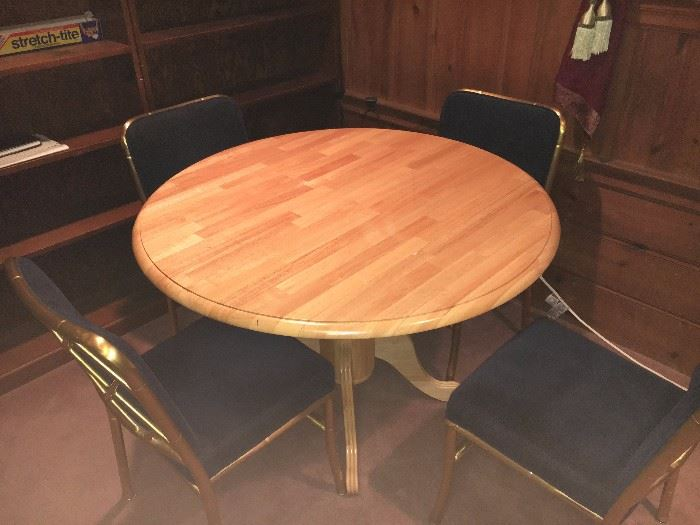Small kitchen/dining table with four chairs