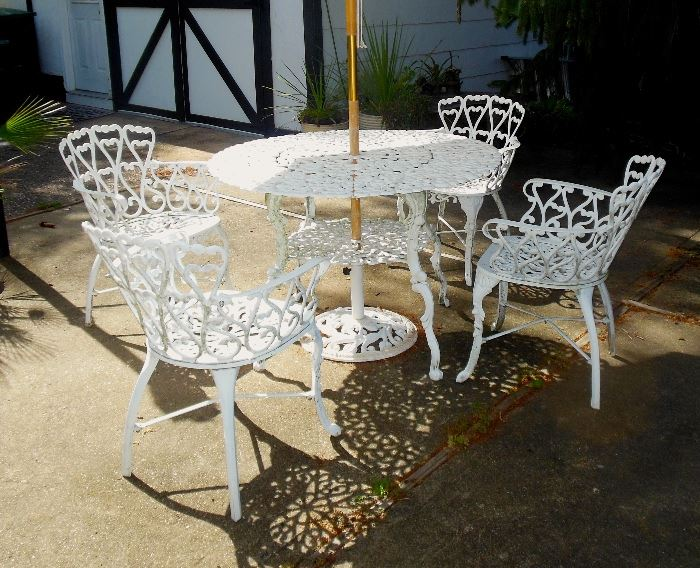 Outdoor Table and Four Chairs With Umbrella Stand