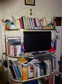 cook books and metal shelf unit   flat screen tv