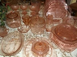 Pink cookie jars, powder jar, covered vegetable, candle holders, grill plates, divided bowl, and more