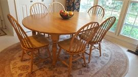 Oval Maple table with 6 chairs    Asking price  $250