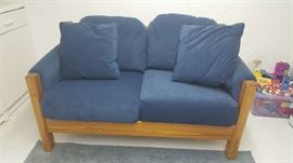 Blue cushion wood frame loveseat    $125