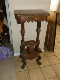 Antique marble-top table w/figurals at the bottom