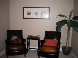 Distressed leather club chairs