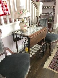 Living Room: Tea Cart, maple wood, dark finish. In sound condition.     Two side chairs, original upholstery in nice condition. Casters on feet.