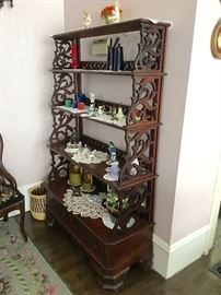 Living Room: Solid walnut etagere. CA 1860, 4 shelves, 2 drawers below, hand cut dovetail, all original and beautiful.