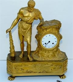 """Empire French Gilt-Bronze Mantel Clock w/ Hercules. CASED IN A CARVED, FAUX TREE TRUNK FLANKED BY HERCULES FIGURE. FRANCE ~ LESIEUR ~ 19"""" h x 14 7/8"""" x 5 7/8"""" d GLASS CLOCK FACE COVER & BACK COVER MISSING"""