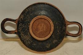 Ancient Greek decorated flat dish with raised rim
