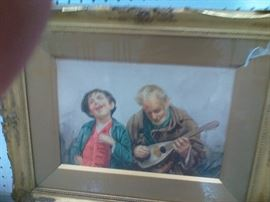 "This Italian watercolor works well with the previous image by Gianni. A young boy enjoys the music an older man plays on a lute. A wonderful addition to any home. Image approx. 9 1/2"" x 13 3/4"", with frame 17 1/2"" x 21 3/4""."