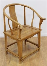 You'd be smart to bid on this Chinese Elm Horseshoe Back Scholar's Chair. It's unique look is from the 19th/20th century.