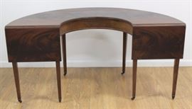"""Regency Style Demilune Mahogany Serving Table is on casters and also has drop left ends. Table is approx. 30"""" H x 59"""" W. and is a stylish way to serve during the upcoming holidays."""