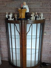 Curved front curio cabinet