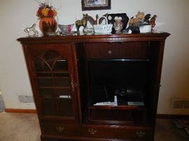 Mahogany Media Center.Holds Flatscreen TV probably up to 30 inches