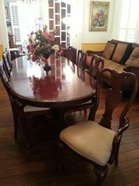 Grand dining table with 8-10 chairs by Thomasville
