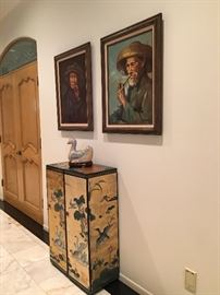 A pair of beautiful lacquered cabinets below paintings by Tang Ping and T Wong.