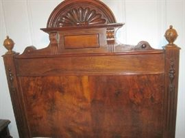 Carving on top and sides of headboard of twin bed