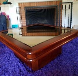 Cherry wood finish coffee table with beveled mirror inset.(Size- 3 feet square).