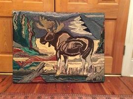 American hooked rug of a moose standing in a stream.