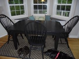 Solid wood dinette set includes 3 chairs. Rug is also available but not the dogs following the camera around.