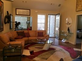 glass top coffee table and side table,  leather sofa sectional , area rugs,  art work (THIS AREA RUG IS NOT FOR SALE )