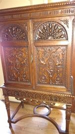 Beautiful 2 pc. carved Cabinet