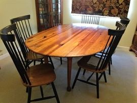 Beautiful dining table with drop leaf sides.  Six chairs