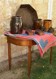 Demi-lune cherry table, primitive quilt, dovetailed wood bowl, various crocks and wood carved trim