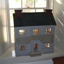Quaint wood dollhouse