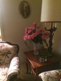 End table; floral arrangement; vintage lamp