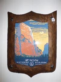Arts & Crafts Movement hammered copper shield-shaped frame with vintage travel poster inside