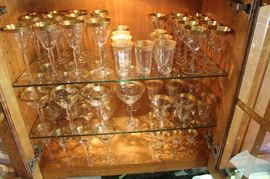 7 sets of gold rim wine, champagne and cordial glasses