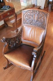 Oak and leather 19th century Scottish rocking chair. Highly carved with original finish. A beautiful piece.
