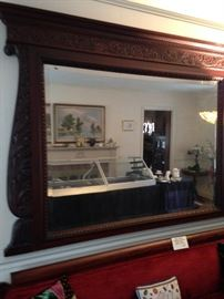 Massive antique mirror with beautiful carved frame.