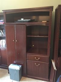 Unique office furniture.  Three piece set includes two bookshelves and this middle section that converts in to a desk.