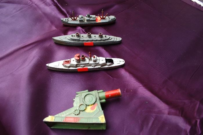vintage Tootsie toy boats, vintage spring loaded Army cannon, made in USA, aluminum.