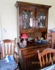Dark pine kitchen hutch, oval table and 4 chairs