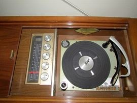 Magnavox console turntable and radio - plus we have records to play on it.