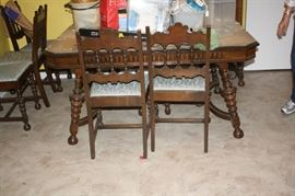 Antique 1920's dining room table and 6 chairs.  Legs on table are gorgeous.