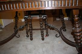Antique dining room table legs.  Note the curved wood and the iron.  gorgeous