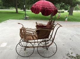 Wicker baby carriage with silk umbrella. Could be purchased new in the Sears catalog for about $8.