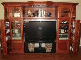 THIS IS A STATEMENT PIECE ! SUPER ENTERTAINMENT/MEDIA WALL CABINET. LIGHTED DISPLAYS, UNLIMITED STORAGE FOR CD'S, DVD'S, ALBUMS, BOOKS, ETC. YES...THE TELEVISION IS FOR SALE!