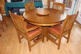 Signed Stickley dining set with leaves and pads