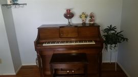 PLAYER PIANO WITH PIANO ROLLS.