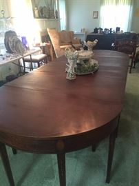 With extra leaves, this lovely dining table accommodates 16.