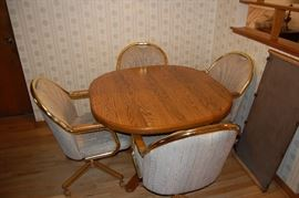Classic kitchen table with rolling captains chairs