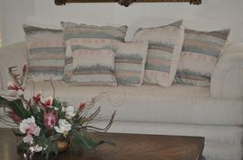 Contemporary Sofa with Matching Loveseat, Coffee Table, Floral Arrangement