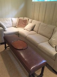 L-shaped Sectional, leather bench and jute area rug