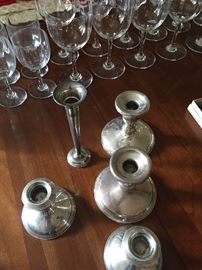 Sterling spoons and weighted sterling candle holders and bud vase