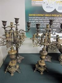 Several ornate pairs of candelabra